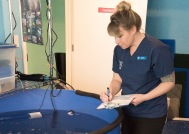 Our hospital manager, Sara, noting the health of our patients